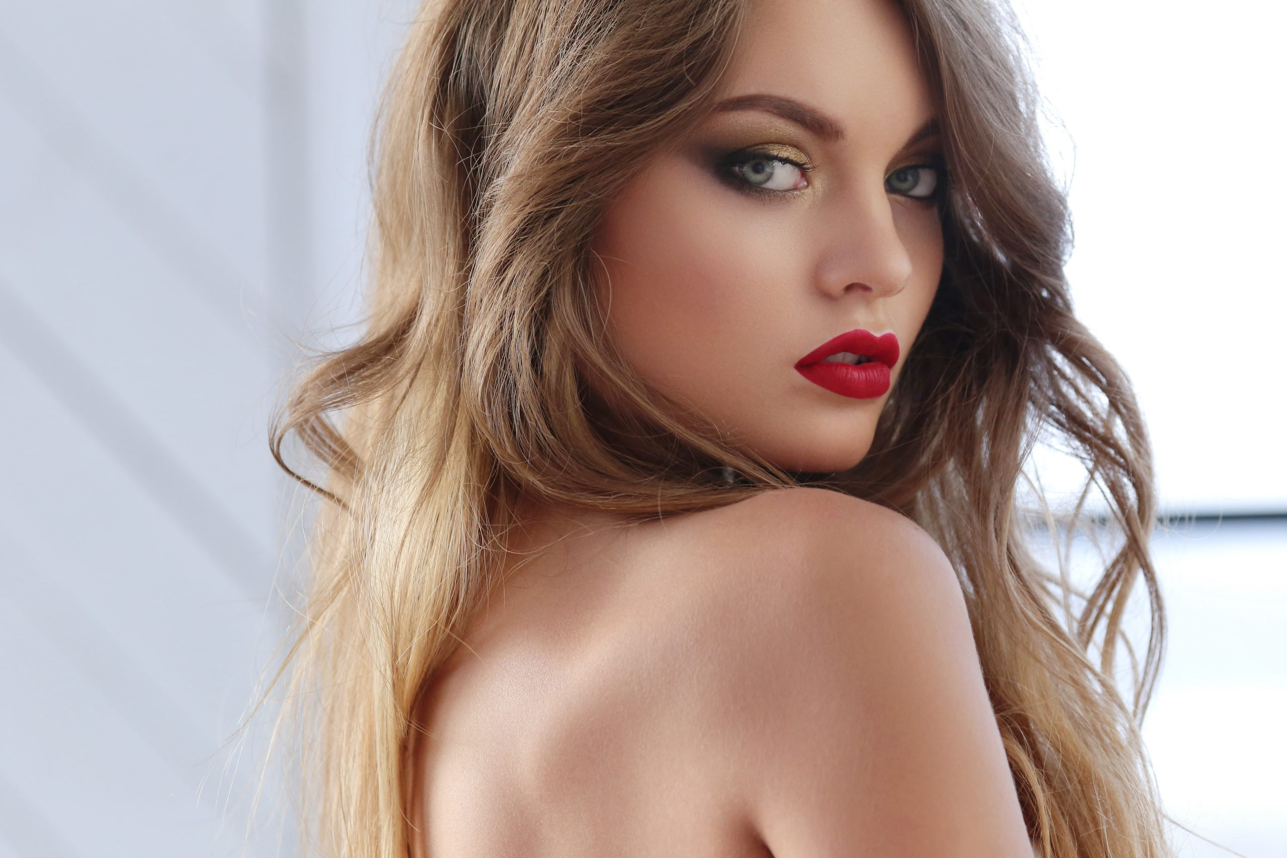 Ukrainian Beautiful woman with blonde hair and red lipstick