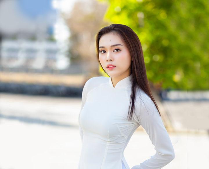 Chinese woman wearing white long sleeve dress