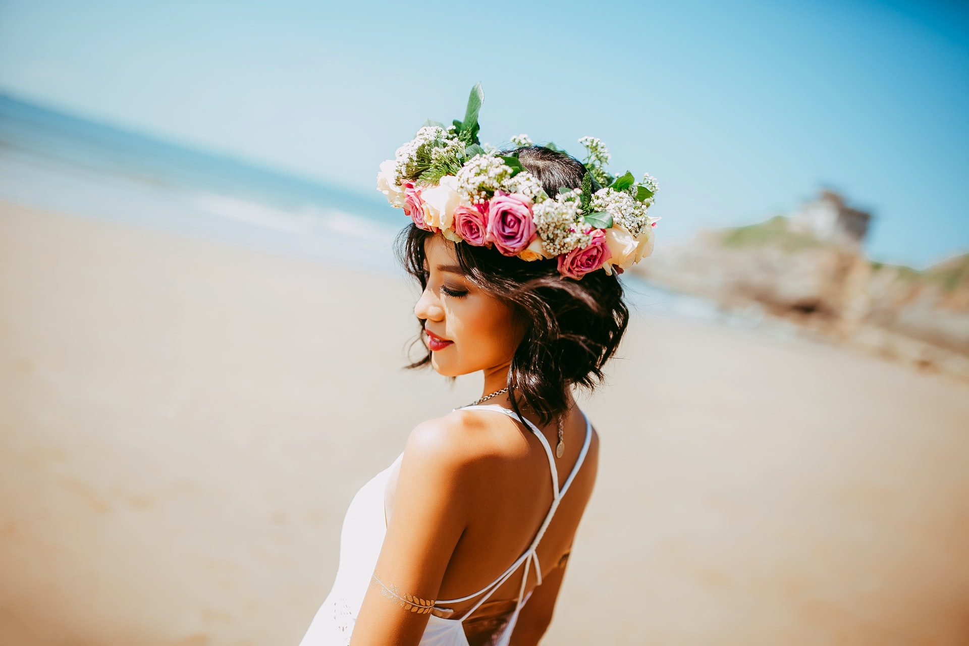 asian girl with flowers in hair